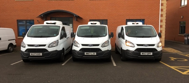 Image of Dex's Midnight runners fleet of Ford custom white vans for vehicle backup courier service